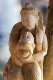 Closeup of Khmer wooden statues of lovers with blurred backgroun Stock Photography