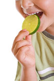Closeup of kid with a slice of lime Stock Photo
