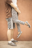 Closeup kissing couple at red wall background Stock Photo