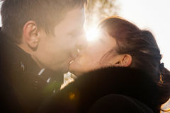 Closeup of kissing couple at sunshine Stock Photo