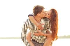 Closeup kissing happy couple Stock Photography