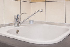 Closeup of Kitchen Marble Sink and Installed New Faucet. Royalty Free Stock Photography
