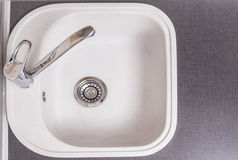 Closeup of Kitchen Marble Sink and Installed New Faucet. Indoors Stock Image