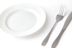 Knife fork and empty plate Royalty Free Stock Photography