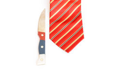 Closeup of knife and red tie Royalty Free Stock Image