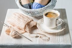 Closeup of knitted scarf with color skein and coffee. On white table Stock Images