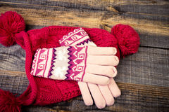 Closeup of knitted winter gloves and cap Stock Photo