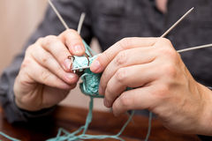 Closeup of knitting male hands Royalty Free Stock Photography