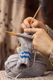 Knitting a sock with bamboo needles Royalty Free Stock Images