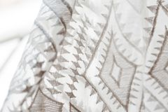 Closeup of lace texture on wedding dress stock image