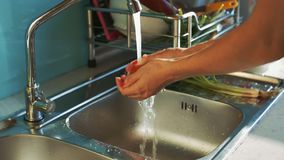 Lady Hands Wash Tomato under Water Jet above Sink. Closeup lady hands wash red ripen tomatoes under water jet above stainless sink and put on plate near dish stock video