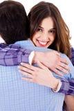 Closeup of lady hugging man. Closeup of smiling young woman hugging man and looking at camera Stock Photos