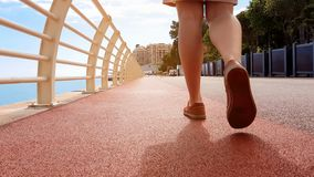 Closeup of lady legs walking along unpolluted pavement, concept of clean city. Stock photo royalty free stock photos
