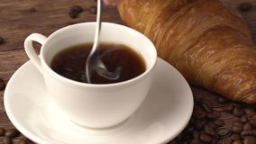 Closeup of lady pouring sugar while preparing hot coffee cup. stock footage