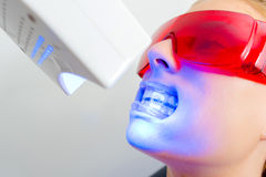 Closeup lady receiving dental treatment royalty free stock image