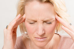 Closeup of Lady with Severe Headache Royalty Free Stock Image