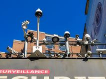 An array of surveillance cameras on top of a shop in Manhattan royalty free stock photo