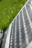 Closeup of laptop. On a green sports field Royalty Free Stock Image