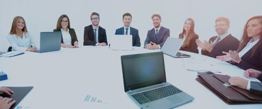 Closeup of business partners complete the work on signing of the Royalty Free Stock Photos