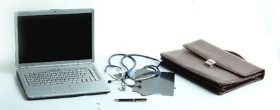 Closeup. laptop and stethoscope in the workplace therapist. The concept of health Royalty Free Stock Images