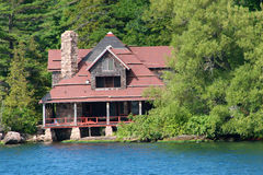 Closeup of a large cabin on a lake Royalty Free Stock Photo