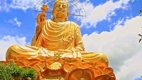Closeup Large Gold Buddha Statue against Blue Sky in Vietnam stock video footage