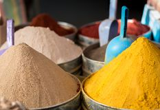 Large piles of exotic colourful spices in moroccan market royalty free stock photo