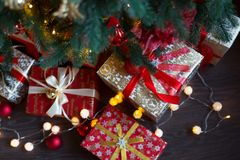 Closeup of a large stack of wrapped Christmas presents of varying sizes and shapes in Xmas interior. Closeup of a large stack of wrapped Christmas presents of royalty free stock images