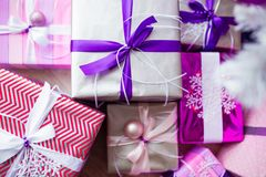 Closeup of a large stack of wrapped Christmas presents of varying sizes and shapes in Xmas interior. Closeup of a large stack of wrapped Christmas presents of stock images