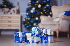 Closeup of a large stack of wrapped Christmas presents of varying sizes and shapes in Xmas interior. Closeup of a large stack of wrapped Christmas presents of stock image