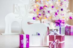 Closeup of a large stack of wrapped Christmas presents of varying sizes and shapes in Xmas interior. Closeup of a large stack of wrapped Christmas presents of royalty free stock photo