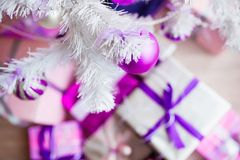 Closeup of a large stack of wrapped Christmas presents of varying sizes and shapes in Xmas interior. Closeup of a large stack of wrapped Christmas presents of royalty free stock photography