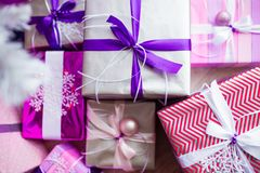 Closeup of a large stack of wrapped Christmas presents of varying sizes and shapes in Xmas interior. Closeup of a large stack of wrapped Christmas presents of stock photography