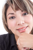 Closeup of latin girl smiling with hand under her Royalty Free Stock Image