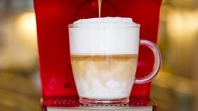 Closeup of latte macchiato preparation stock video