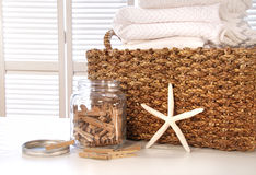 Closeup of laundry basket with fine linens Royalty Free Stock Photography