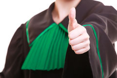 Closeup of lawyer attorney wearing classic polish gown showing thumb up Stock Photography