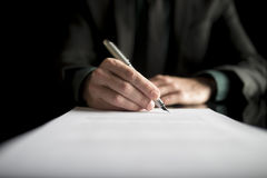 Closeup of lawyer or executive signing a contract royalty free stock image