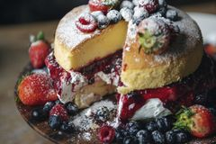 Closeup of a layered cake with berries royalty free stock images