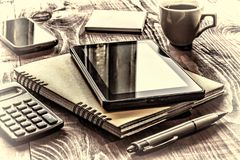 Closeup Layout workplace in the office. Square shot, Tablet PC, notebook, pen, stickers royalty free stock image