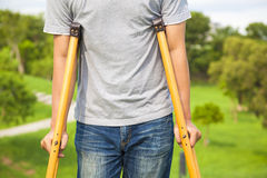 Closeup of leg on bandage with crutches Royalty Free Stock Photos