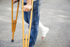 Closeup of leg on bandage with crutches Stock Photo