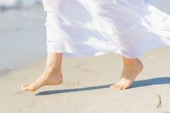 Closeup on leg of woman on sea coast Royalty Free Stock Image