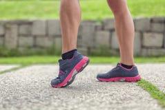 Closeup legs of female walker in park Stock Photo