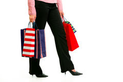 Closeup on legs and hands with shopping bags Stock Photos
