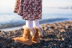 Closeup of legs little girl in cozy fur boots Royalty Free Stock Image