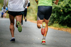 Closeup of legs male runner running Stock Images