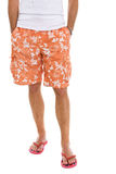 Closeup on legs of male in shorts and flip flops Royalty Free Stock Photos
