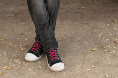 Closeup of legs in trousers and sneakers Royalty Free Stock Photography