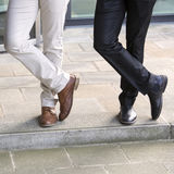 Closeup of legs of two businessmen standing outside Royalty Free Stock Photo
